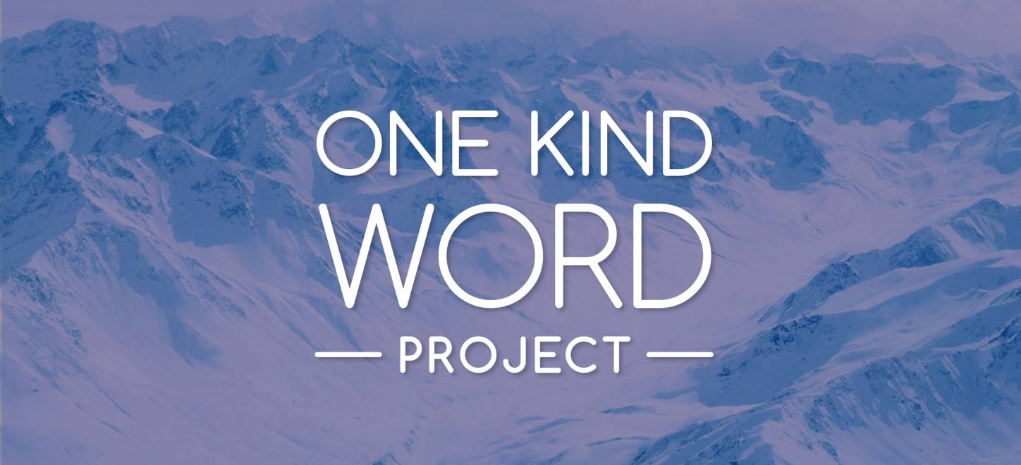 One Kind Word Project logo on snow covered mountains