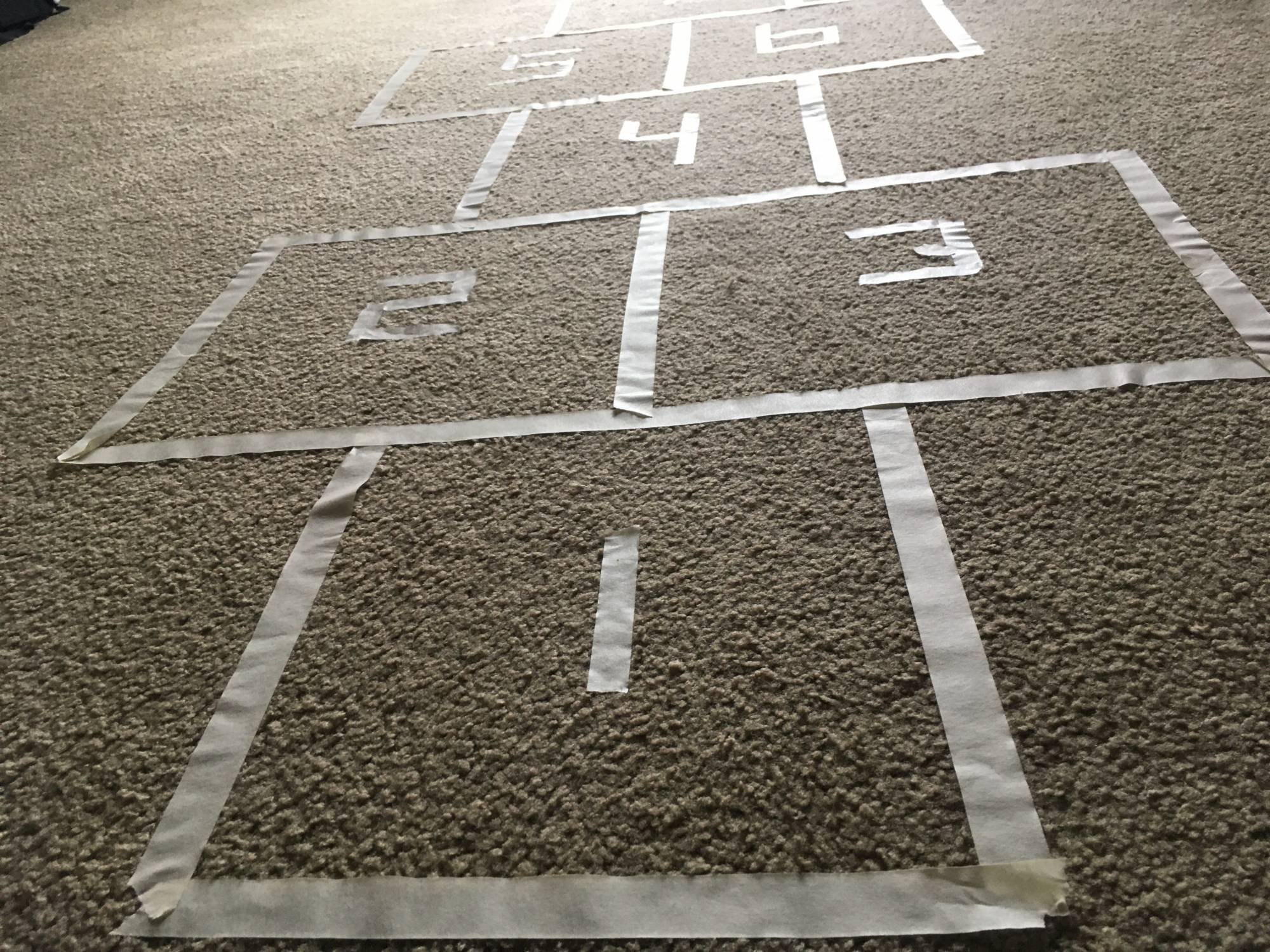 Hopscotch made from masking tape on carpet