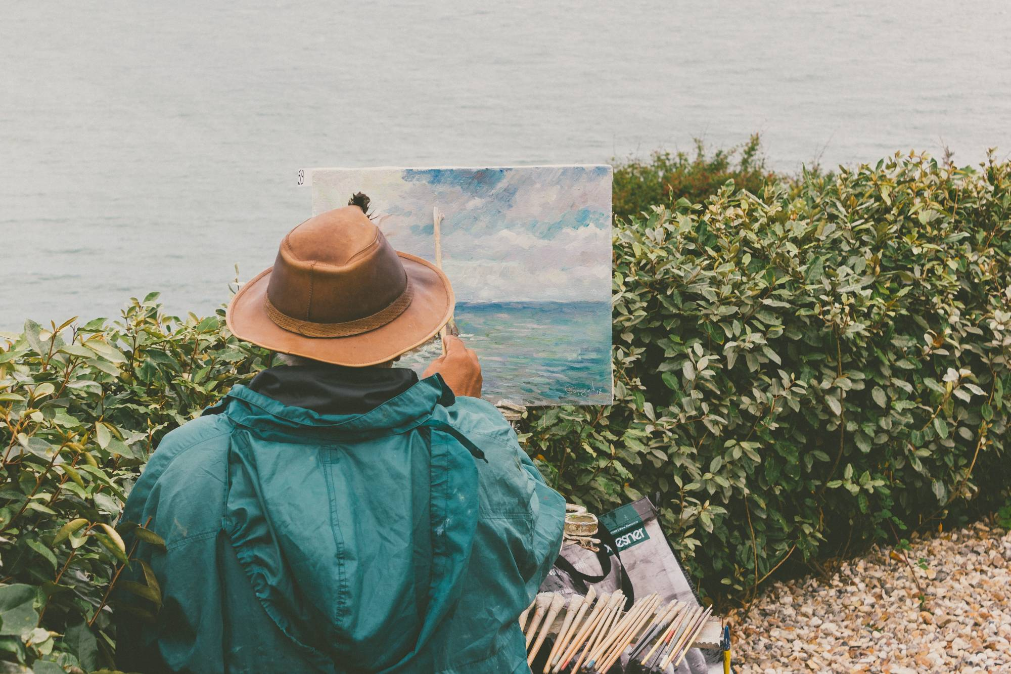 man painting landscape