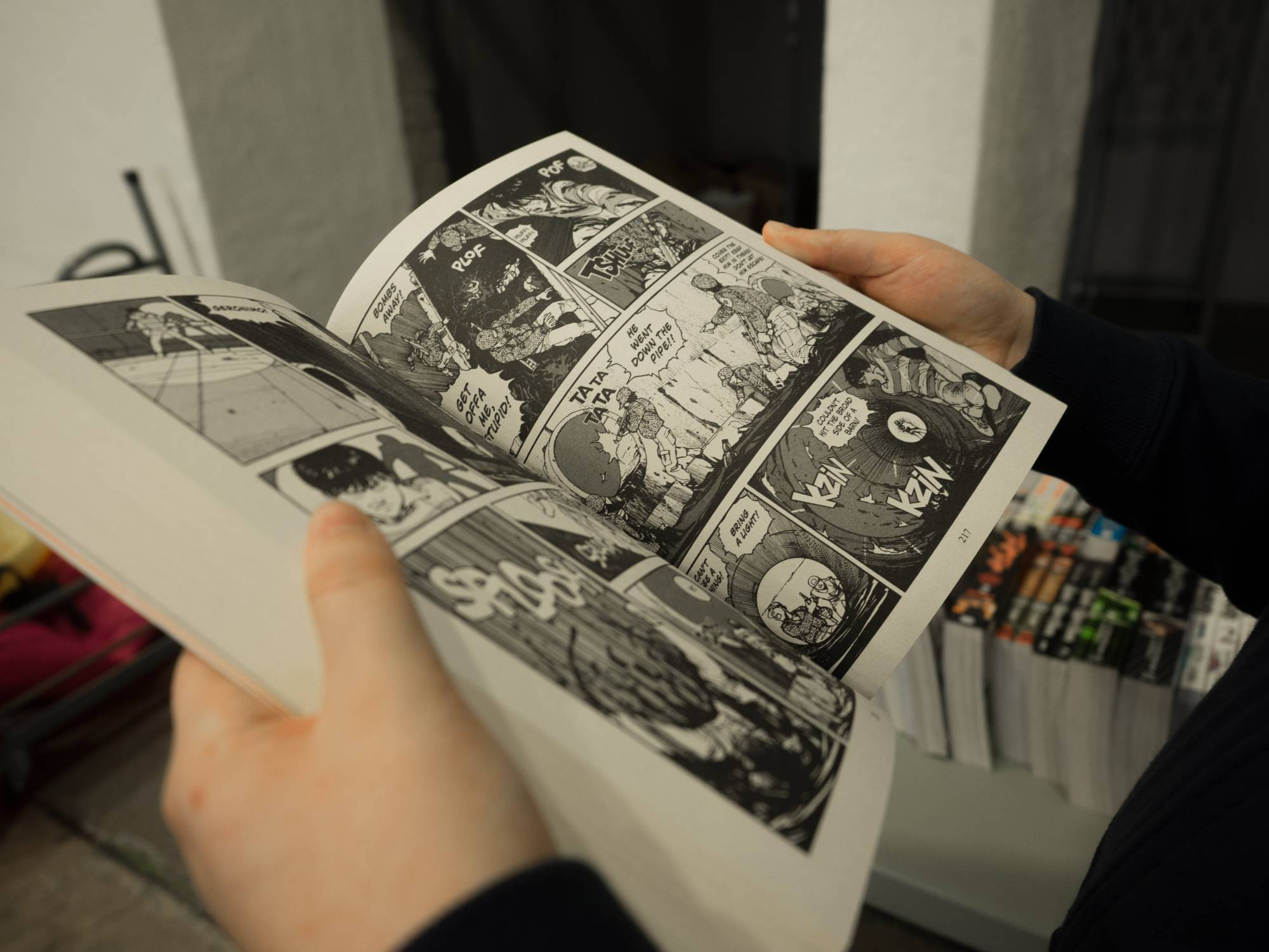 Person holding comic book