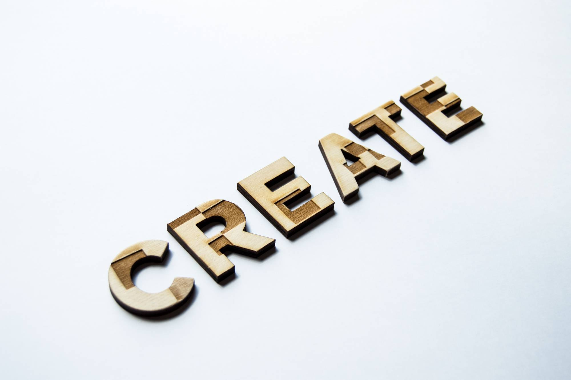"Laser cut sign of ""Create"""