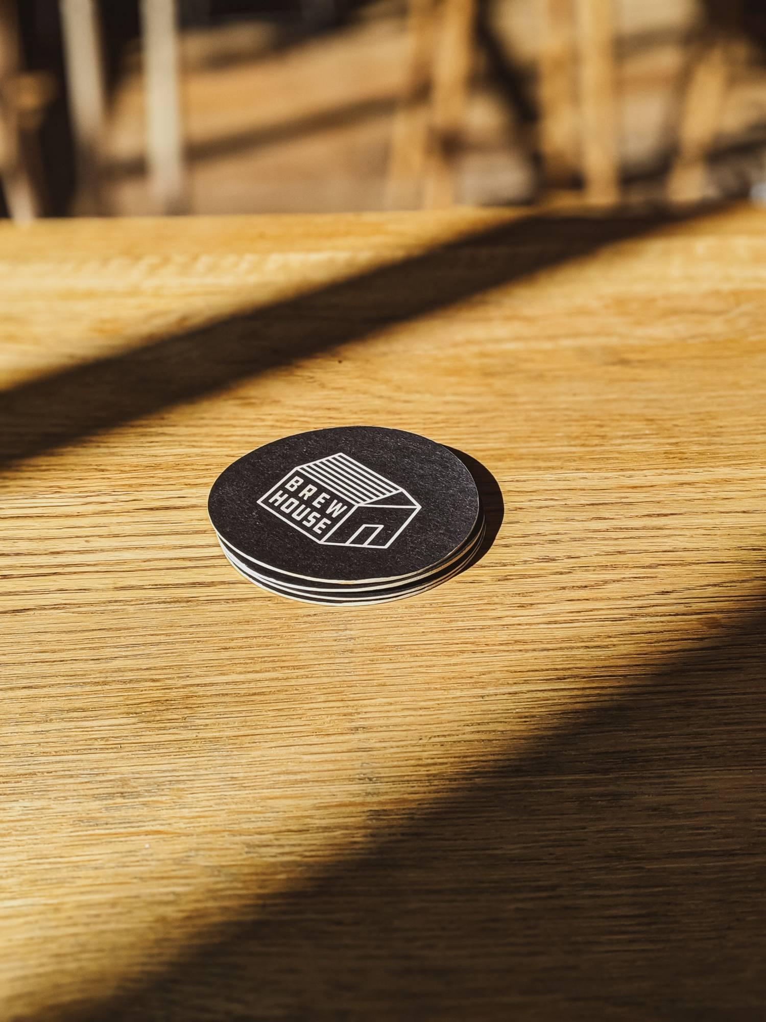 Black coaster on table