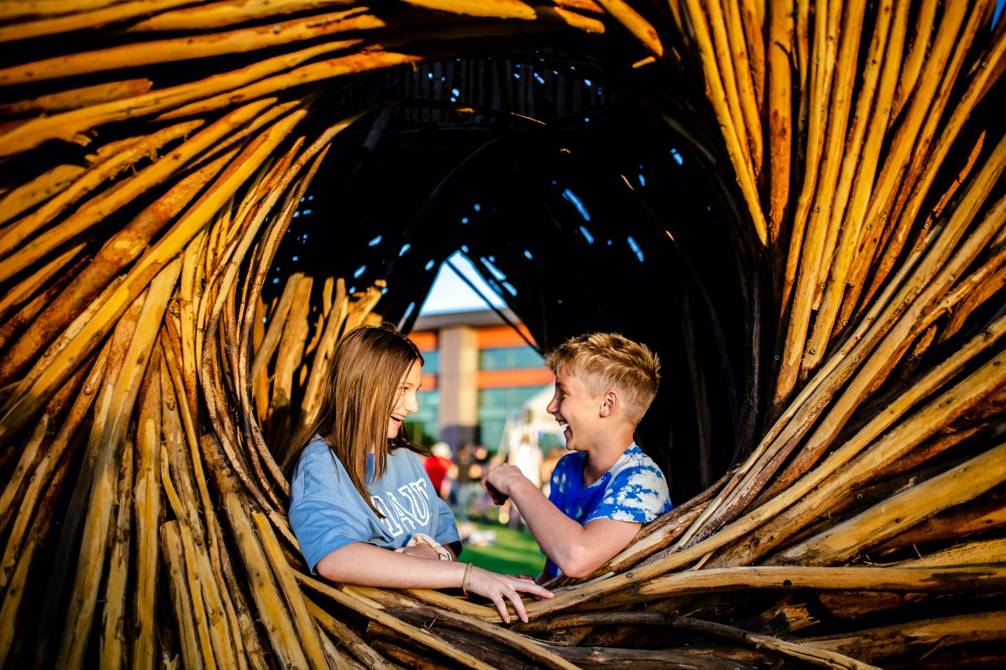 Two children play in the spirit nest at Anythink Wright Farms