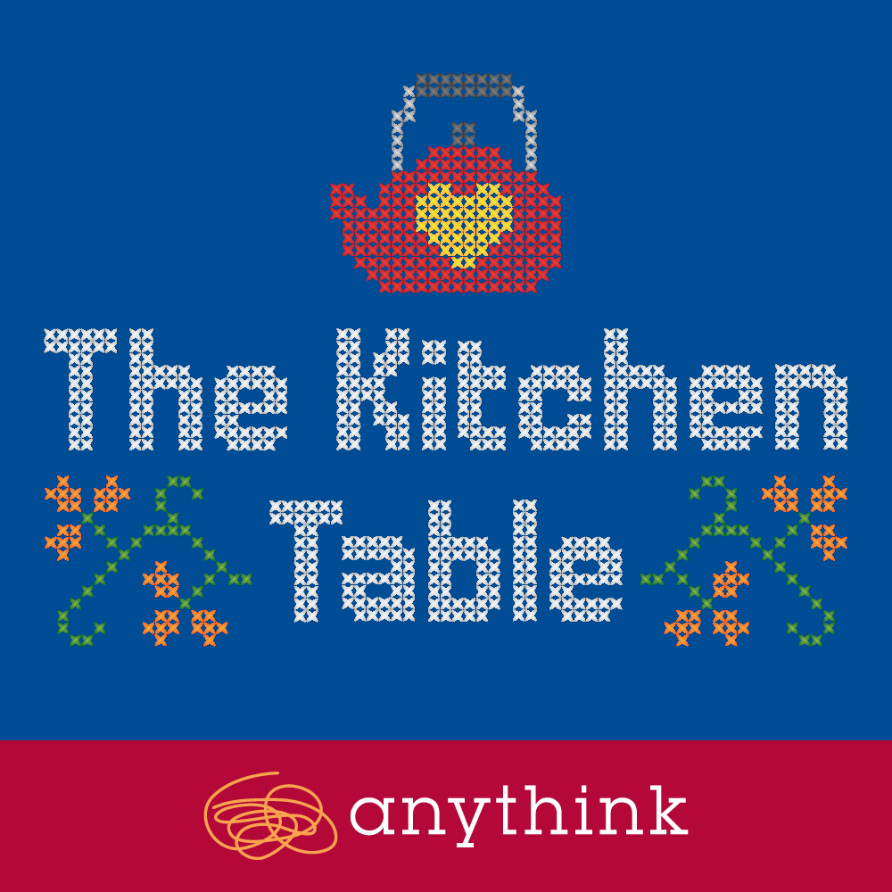 The Kitchen Table logo with cross-stich and a kettle