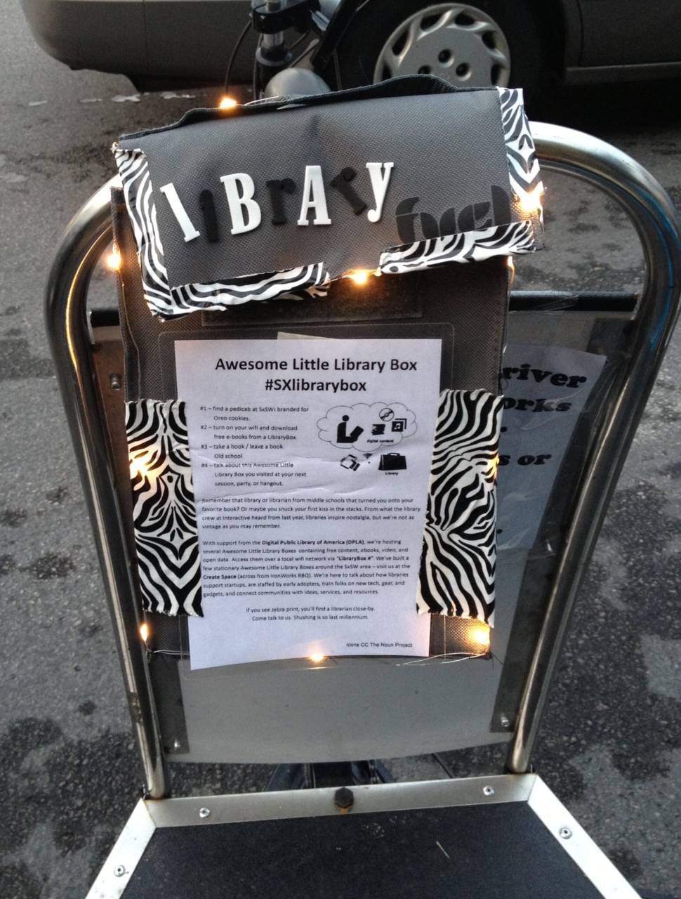 Awesome little free library box on the back of one of Austin's pedicabs