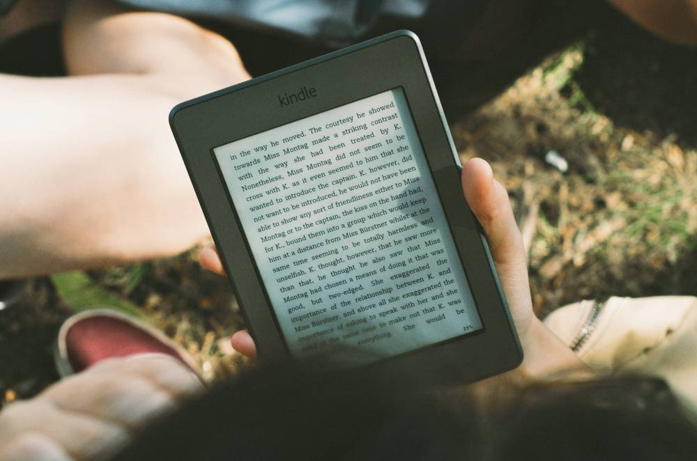 Photo of someone reading an ebook on an Kindle