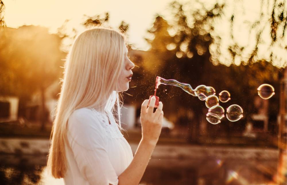 Lady blowing bubbles