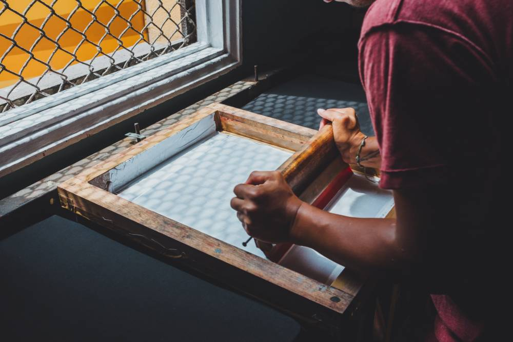 Man screen printing