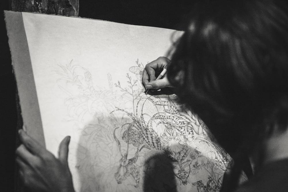 person drawing with ink