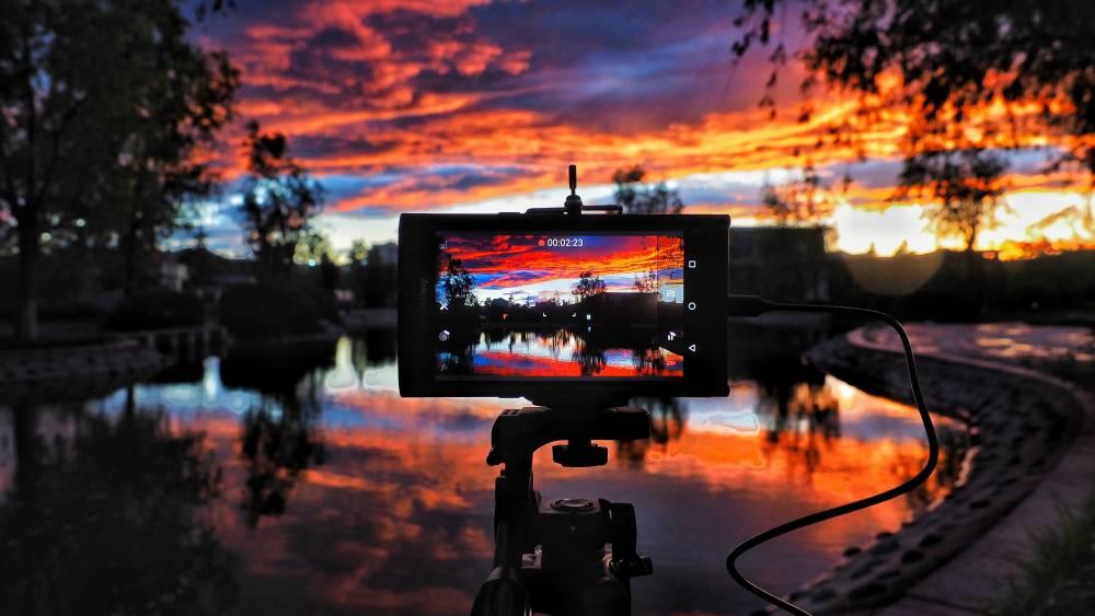 Camera on tripod setup during golden hour