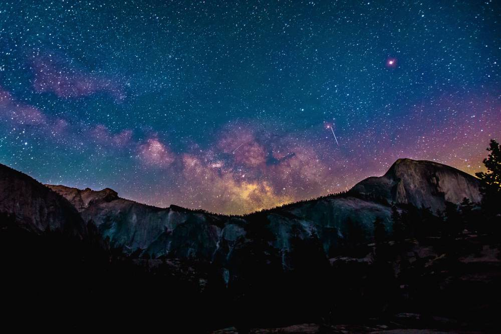 Starry night set behind mountain scape