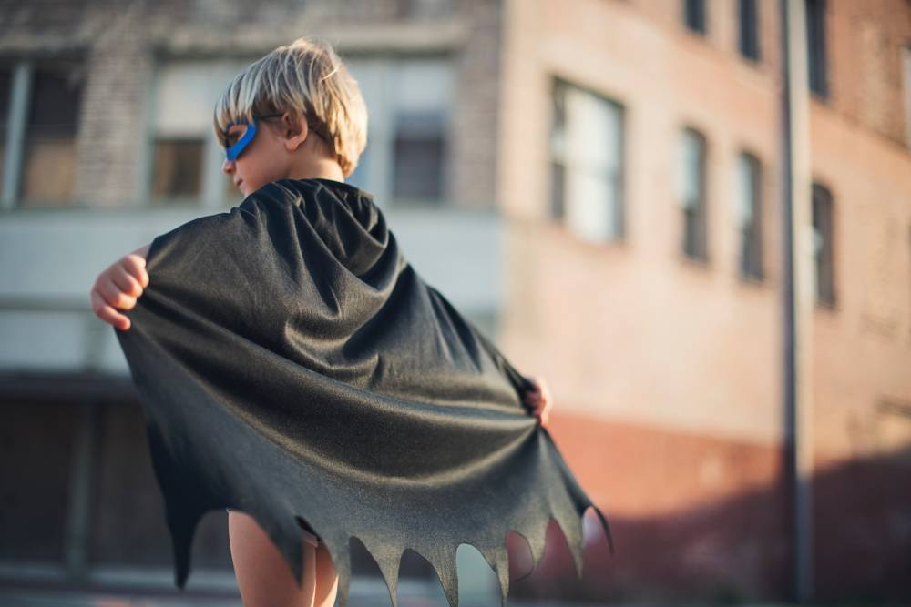 Boy in cape and mask