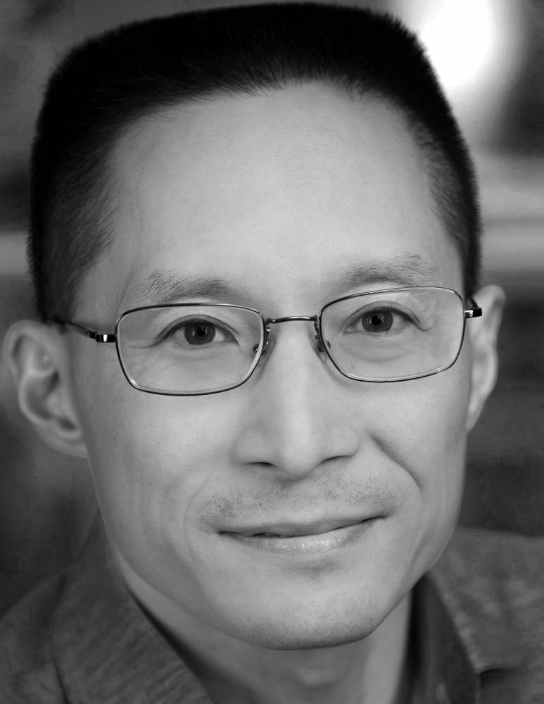 Black and white headshot of Eric Liu