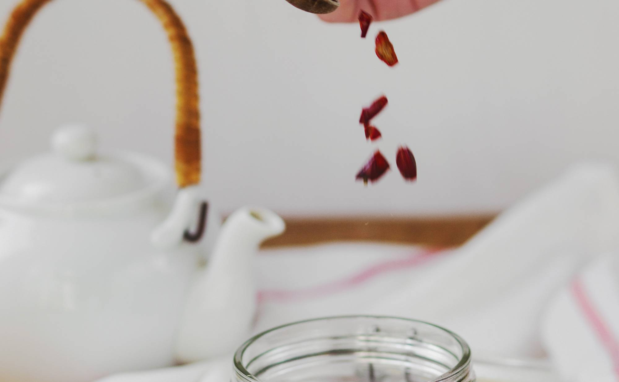 Person pouring spice into jar